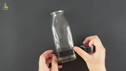 Make a flower vase from a glass bottle