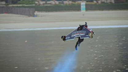 Mind blowing history making manned wing suit flight!