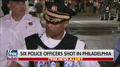 Philadelphia police: Suspect alive, negotiating with cops